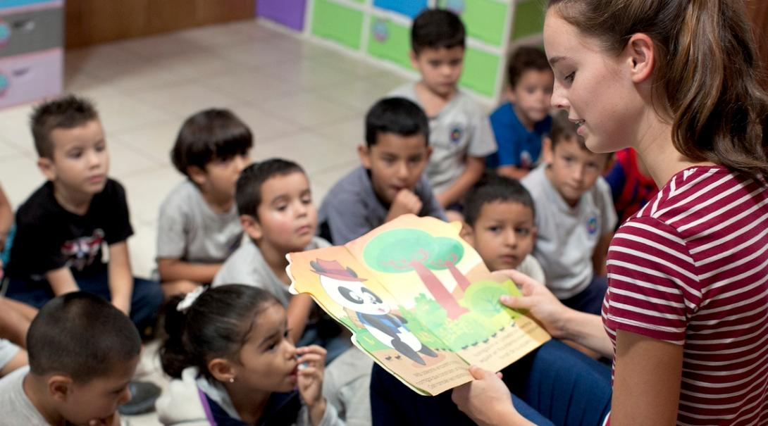 Volunteer opportunities include reading books with children in Costa Rica